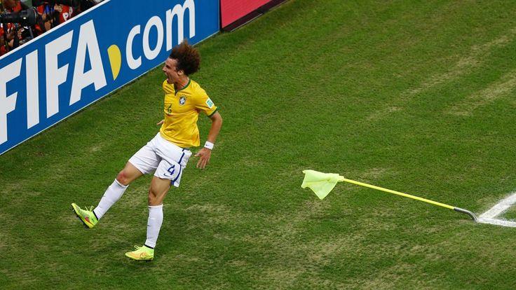 David Luiz of Brazil celebrates scoring