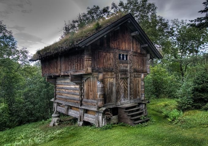 Old Norwegian log dwelling with wood carving details ..  so cute and tiny, I dont see any windows though so I don't know if it was actually a real cottage or just a shed or outbuilding