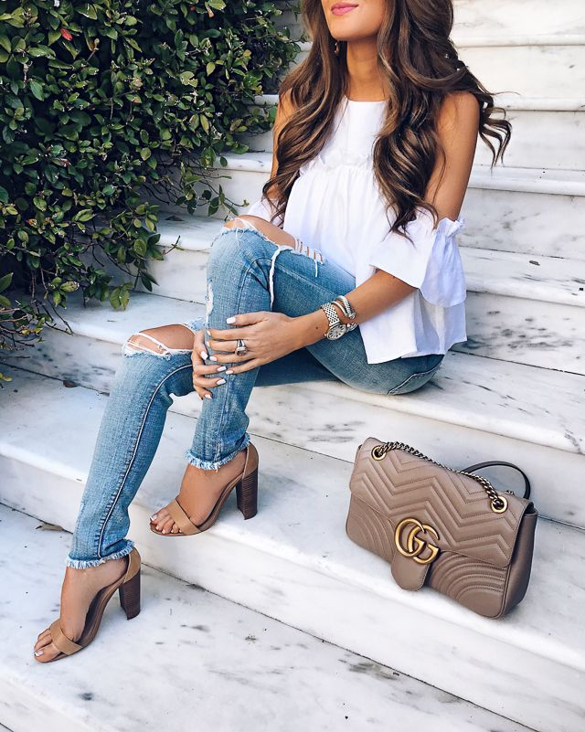 ripped jeans, white cold shoulder top, Gucci Marmont handbag