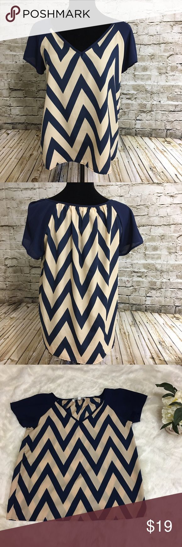 "Chevron Top Blouse Navy Blue cream Elegant top. Flowy, loose fitting. Purchased at Francesca. Worn once. Perfect condition. Great for traveling ( doesn't wrinkle). Measurements: armpit to armpit 19"", back to hem 24"". Annabella Tops Blouses"