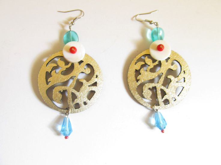 Handmade laser cut leather earrings (1 pair)  Made with gold leather filigree and glass beads.