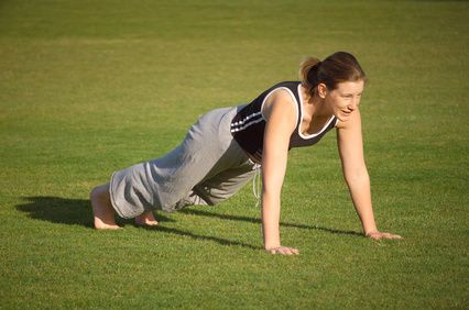 Single burpee with pushup: Begin in standing position. Bend legs to a squatting position and place hands beside your feet, shoulder width apart. Thrust both feet out behind you and land in the push-up position so that your body is straight, your arms are straight and your core is tight. Do push up. Jump your feet back to your hands, then straighten your body, finishing with an upright jump.