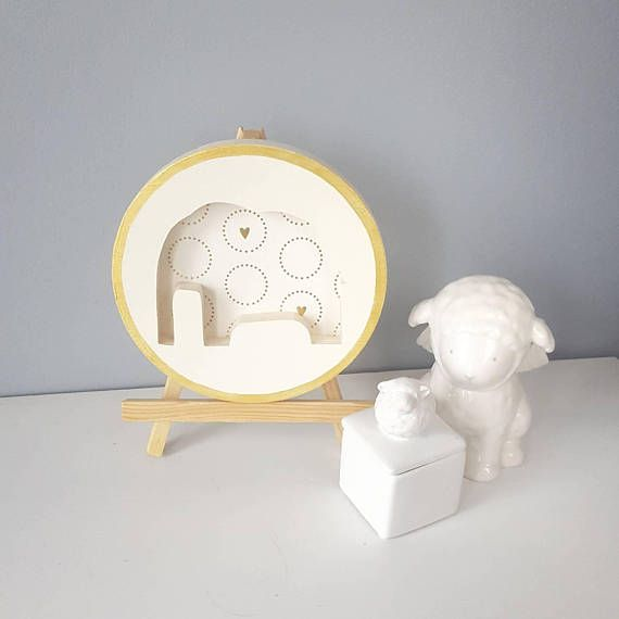 Elephant Wall Art makes a lovely gift for New Parents or Baby Showers. This keepsake Wall Art is Gender Neutral in its Class is colors of Cream and Gold #elephantdecor #elephant #nursery #babyboy #nurserydecor #handmade #babygirl #baby  https://www.etsy.com/ca/listing/581807180/elephant-wall-art-nursery-decor-gift-for