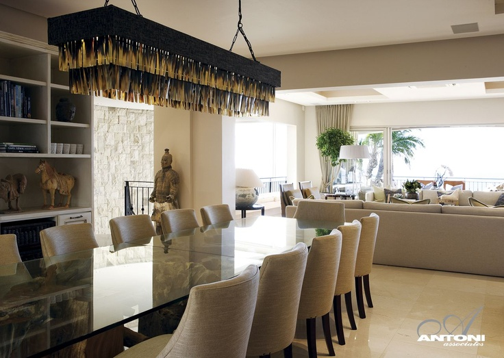 Glass dining room table, interesting overhead light feature