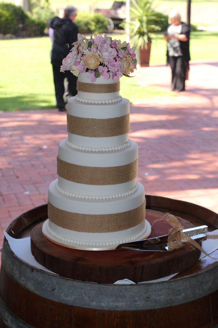 Rustic Wedding Cake with flower boquet.