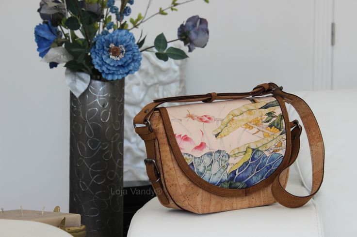 Have a cork bag to match with Spring.Natural cork and painted leather.