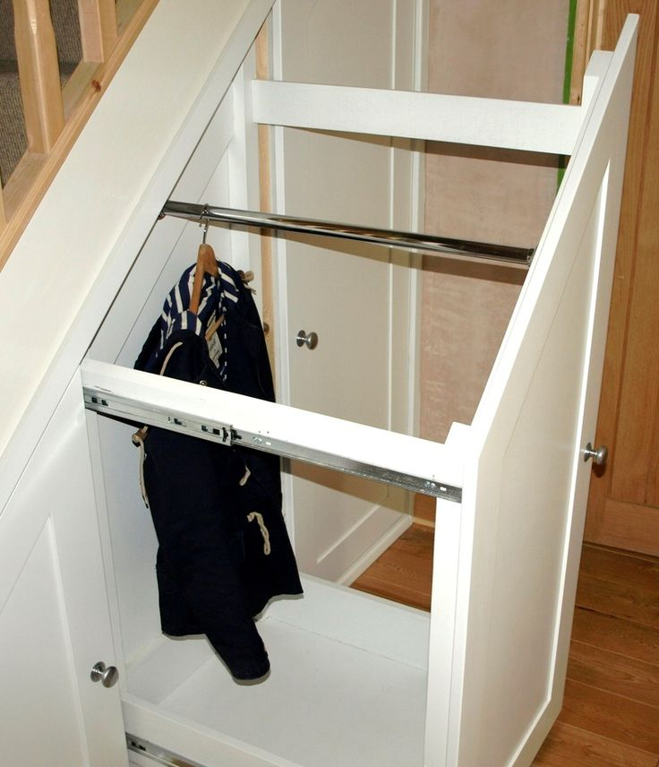 Under stair wardrobe - what a great idea for storing seasonal items !!!