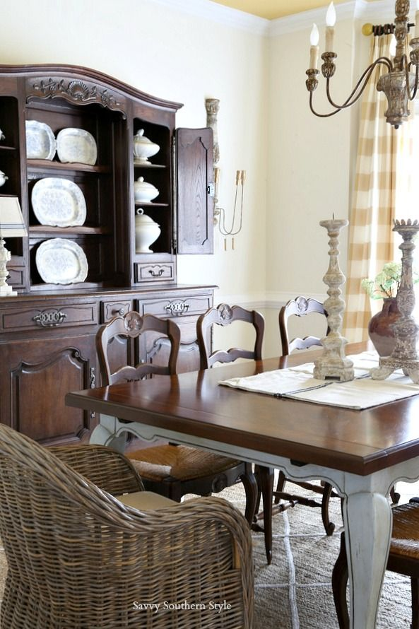kubu and antique French dining chairs in a French country dining room