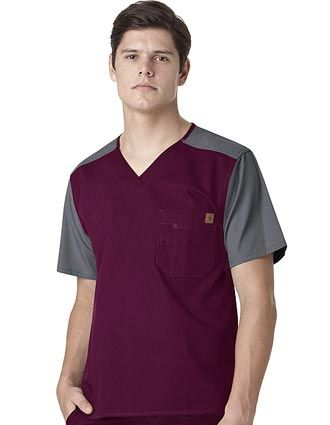 Style Code: (CA-C14108)  Reach for our color block utility scrubs whenever there's a long day ahead of you. Built Carhartt strong, it's constructed in 55% cotton/45% polyester brushed micro canvas with triple-stitched main seams. Comfortable, too, it features a bi-swing back for ease of movement, a tagless neck label, and a drop tail that's two inches longer than the front. The left-chest tradesmen pocket includes a pen stall to hold your pens securely in place.