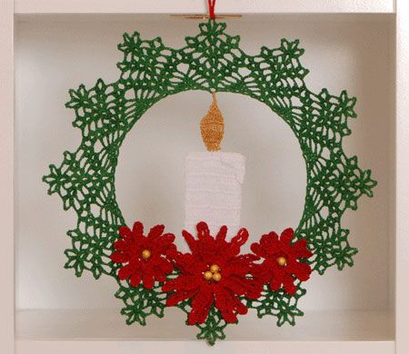 This delicate thread crochet wreath featuring a candle and poinsettias would make a wonderful Christmas decoration for a front window in your home.