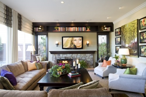 traditional family room by Robeson Design  Fireplace & TV over mantle