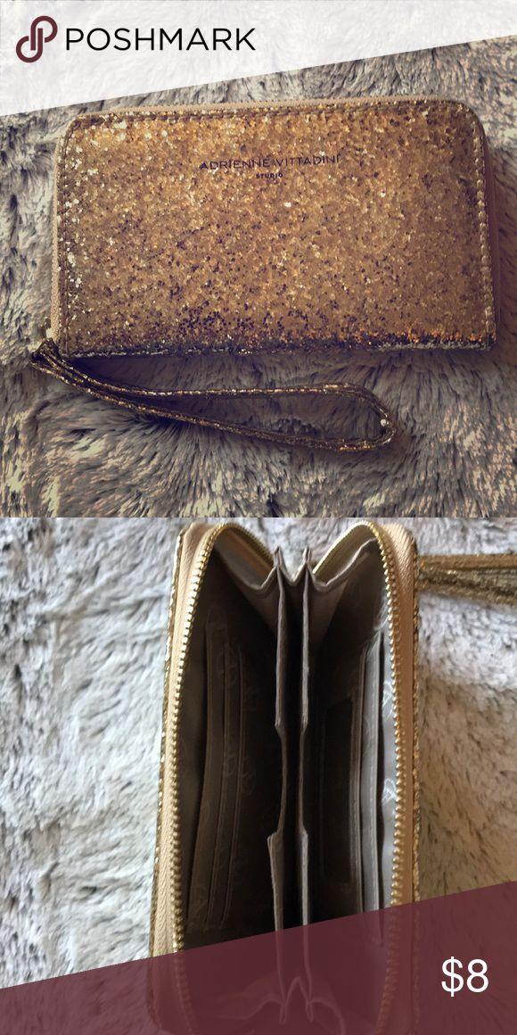 Adrienne Vittadini Gold Wristlet Gorgeous AV Wristlet will look amazing on your wrist! This is perfect for special occasions, a night out on the town or every day use! Perfect condition- only used twice. 5 credit card slots with middle divider. Holds my iPhone 7Plus! Adrienne Vittadini Bags Clutches & Wristlets