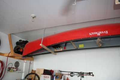 Garage Canoe Storage (someone mentioned wrapping an old towel around the 2x2 for added protection)