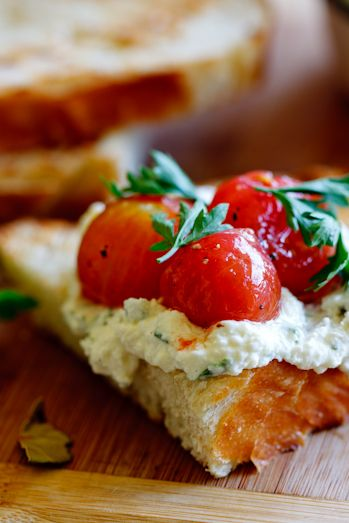 <3 Marinated cherry tomatoes with whipped ricotta on Sourdough