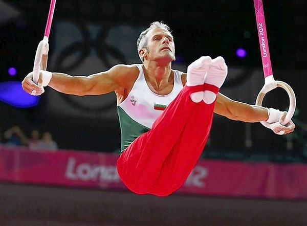 39 year old Jordan Jovtchev of Bulgaria competes in the men's gymnastics rings final. Gray hair and all... love it.