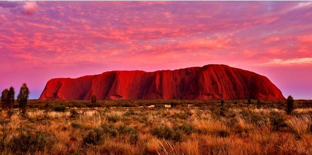 Rising out of the surrounding Central Australian desert, is one of Australia's most recognisable natural landmarks. The local Anangu, the Pitjantjatjara people, call the landmark Uluṟu. This word has no particular meaning in the Pitjantjatjara dialect, although it is used as a local family name by the senior Traditional Owners of Uluru.   #ayers rock #landmark #uluru