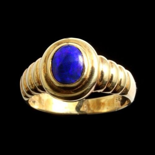 opal ring: Heavy 18k yellow gold ring with solid blue black opal from the Lightning Ridge field. Genuine black opal. Shipping free