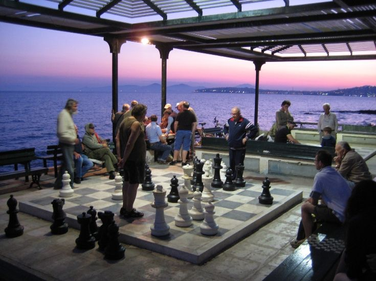 A chess game on this outdoor chess board at Faliro coast (Athens riviera, Greece)