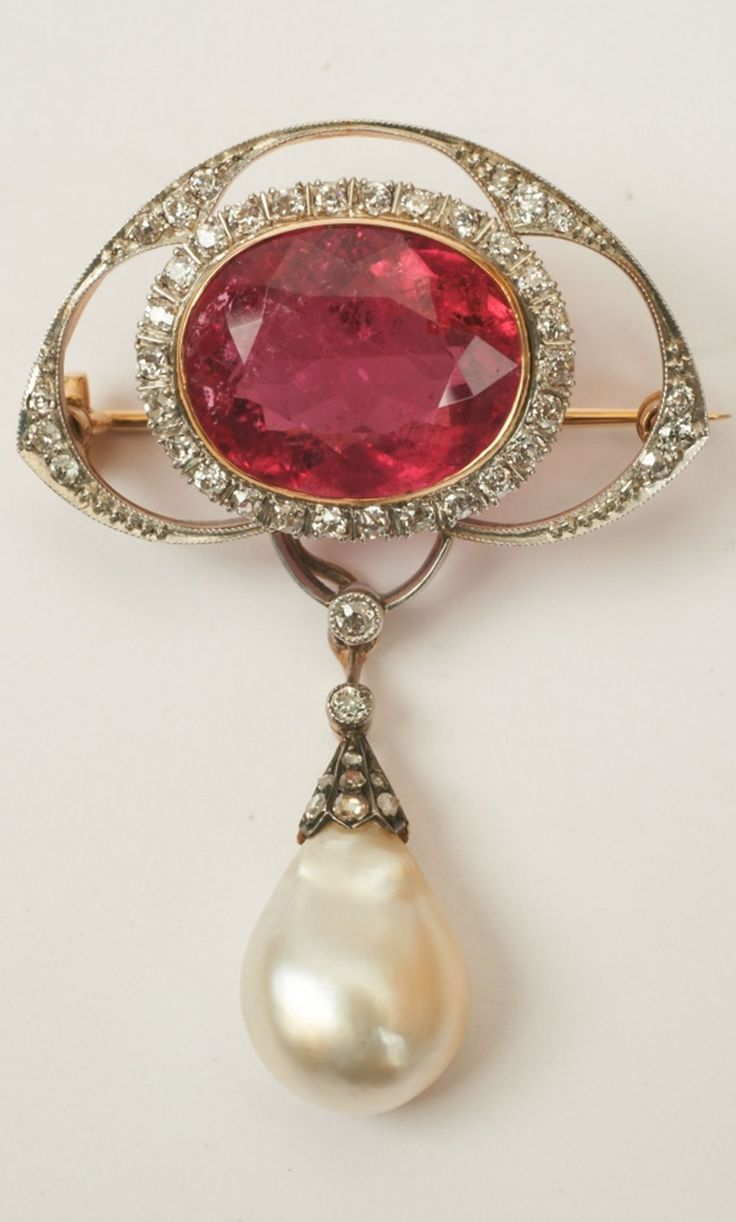 "A Belle Epoque gold, diamond, pink rubelite and Oriental pearl brooch, German, early 20th century. Can be converted to a pendant via a diamond set hook and a platinum chain. In the original fitted case marked ""E. Schürmann Hofjuwelier Wiesbaden"". Brooch length 5.5 cm. #BelleÉpoque #brooch #pendant"
