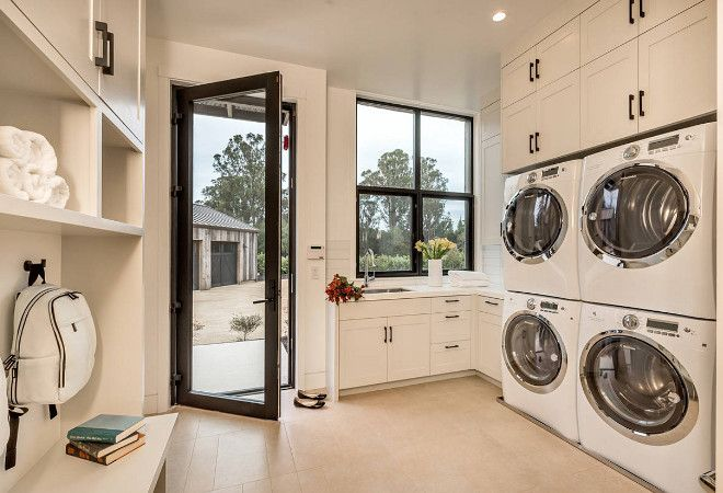 Laundry room with double washer machine and double dryer machine. Two washers and two dryer machines in laundry room.…