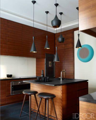 Walnut-veneer kitchen island and cabinetry.