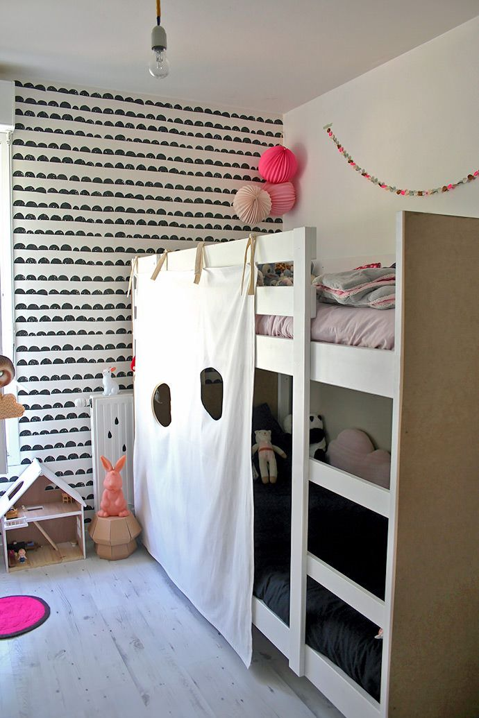 Turn your child's bunk beds into a super fun secret fort with this simple IKEA hack!