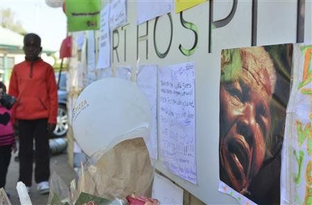 A poster and get well messages are seen outside a Pretoria hospital where former South African President Nelson Mandela is being treated