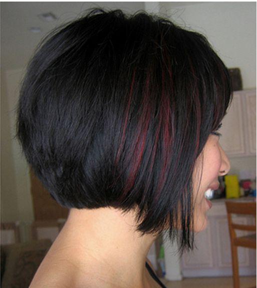 Subtle red highlights on short black hair
