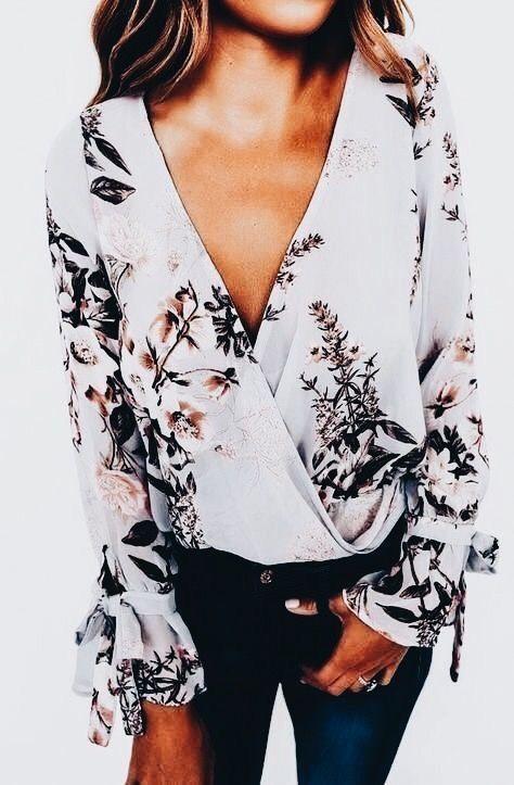Pretty print blouse with denim jeans.