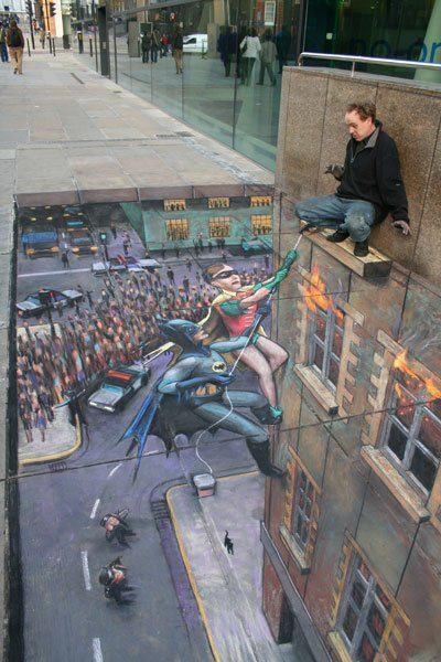 The man on the ledge is actually on the sidewalk on a drawing. Look closely and let it sink in. ;>)): Chalkart, Sidewalks Chalk Art, 3D Street Art, Batman Robins, Chalk Drawings, Sidewalkart, Sidewalks Art, Julian Beever, Streetart