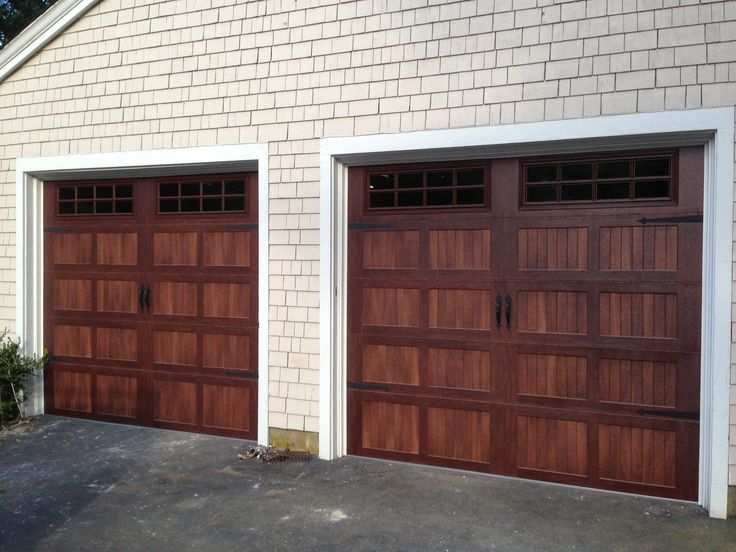 @C.H.I. Overhead Doors model 5216 Faux Wood Steel Carriage House Style Garage Doors in Mahogany Accents Woodtone with Stockton Glass & Flat Black Spade Decorative Hardware. Installed by Mortland Overhead Door. mortlanddoor.com