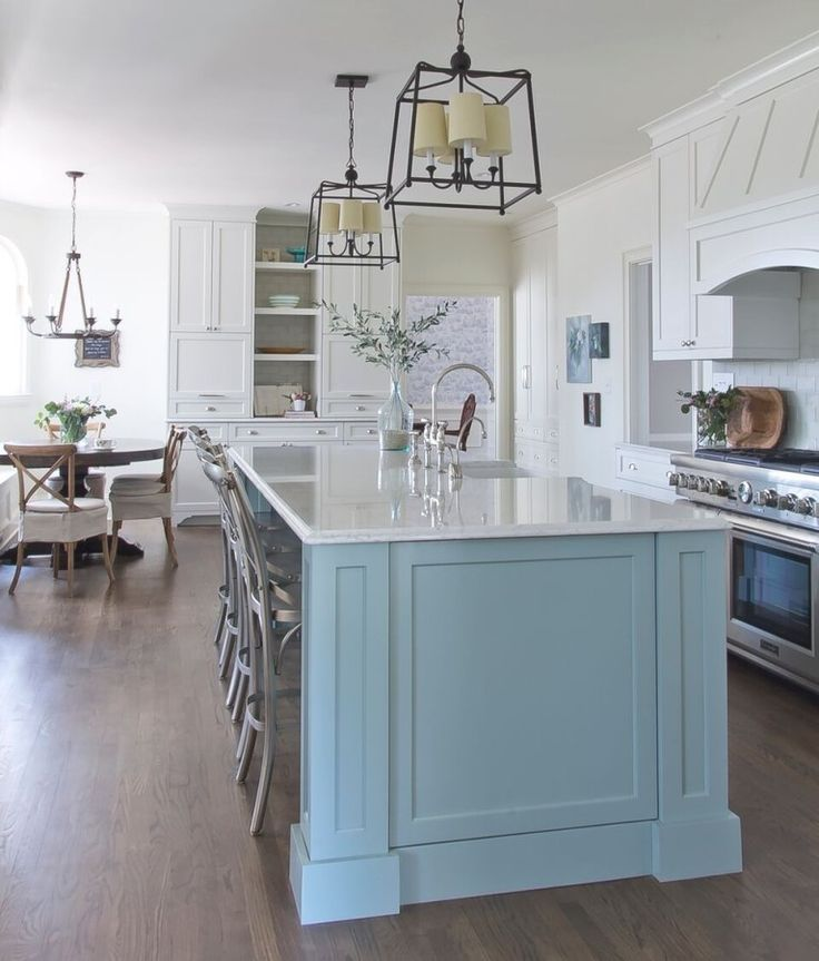 Island color is Halcyon from Sherwin Williams. Stunning kitchen.  Blue island is the star of the space. Milk and Honey Home