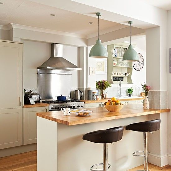 Like the wooden top on island and pendants Neutral kitchen with wooden  painted island | Kitchen