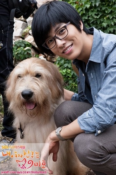 no min woo LOOKS SO CUTE IN THAT OUT FIT I REALLY LIKE THE GLASSES ON HIM AND HE IS SO COOL WITH THE DOG