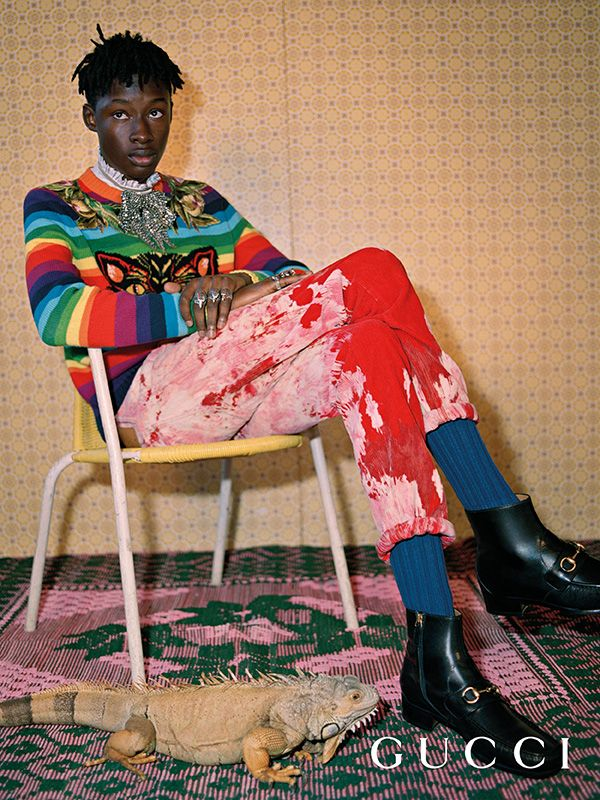 Lensed by Glen Luchford for the new Gucci Pre-Fall 2017 campaign, red bleached velvet corduroy pants and a wool knit with patch details by Alessandro Michele.