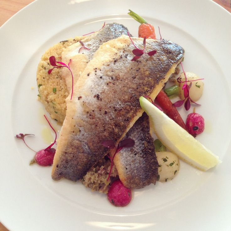 Branzino Sea bass fillets served with Italian olive tapenade, Mediterranean couscous salad and honey and thyme roasted root vegetables.