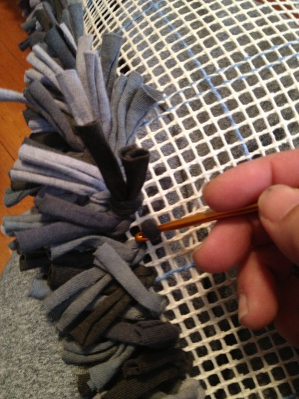 DIY rag rug latch-hooked with t-shirt scraps