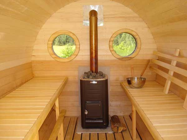 The barrel sauna is a enlarged wine barrel made into a sauna. They are popular because of the rounded edges that let the moisture roll off the walls. I have done some research and discovered that a couple of the barrel sauna builders also offer a bunkie option.