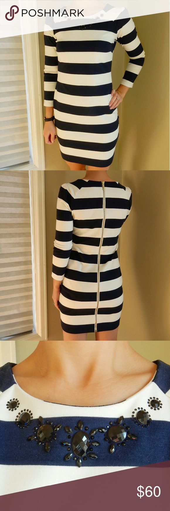 Juicy Couture 3/4 Sleeve Striped Cocktail Dress Juicy Couture navy and white striped cocktail dress. 74% polyester, 22% viscose, 4% elastane. Gold zipper detail on back full length of dress. Black plastic beading detail on front neckline. Perfect for fall/winter events! Juicy Couture Dresses Long Sleeve
