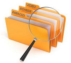 una lente di ingrandimento che cerca video, esercizi, schede