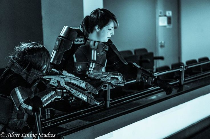 Myself cosplaying as N7 armour female Commander Shepard, and L2 Biotic Cosplay (https://www.facebook.com/L2Bioticcosplay?fref=ts) cosplaying as Kaidan Alenko from the Mass Effect video game trilogy. Photo taken by Giles Warhurst of Silver Lining Studios (https://www.facebook.com/pages/Silver-Lining-Studios/1564999847103681?fref=photo)