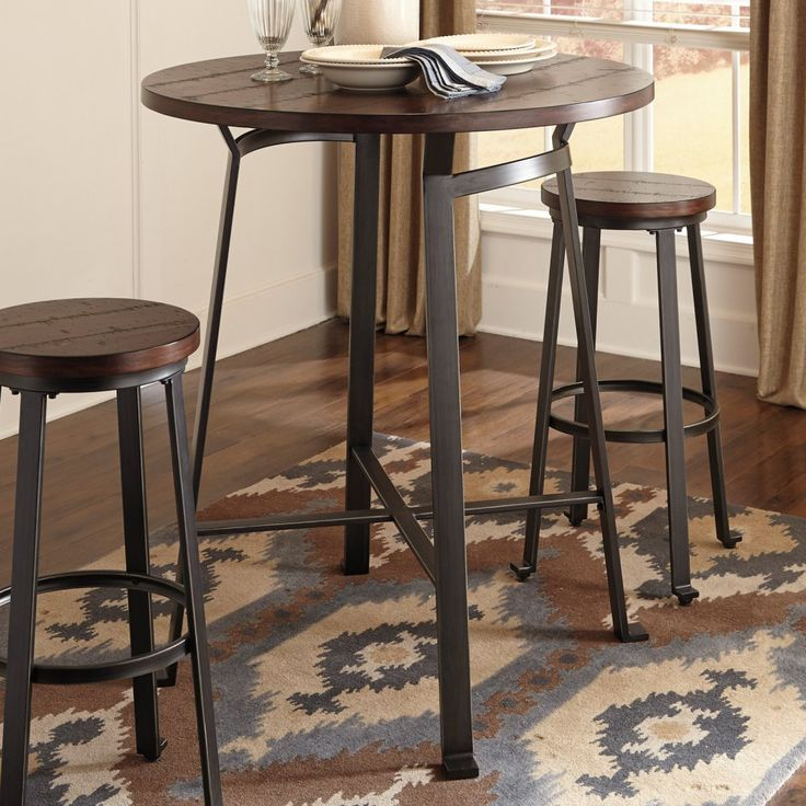 Signature Design by Ashley Challiman Round Pub Table Add industrial style and elegance to your