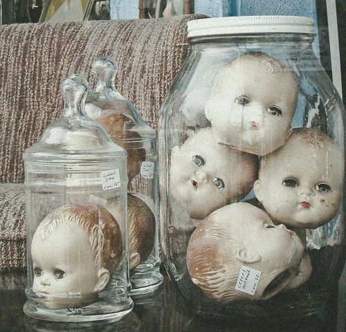 Baby doll heads....crazy creepy, like it.  I bet I'll have a few by Halloween...