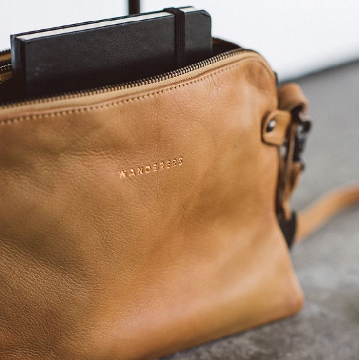 """""""The Venetian"""" full grain leather passport travel clutch in tan by Wanderers Travel Co. wandererstravelco.com Photo by @scottsurplicephotography"""