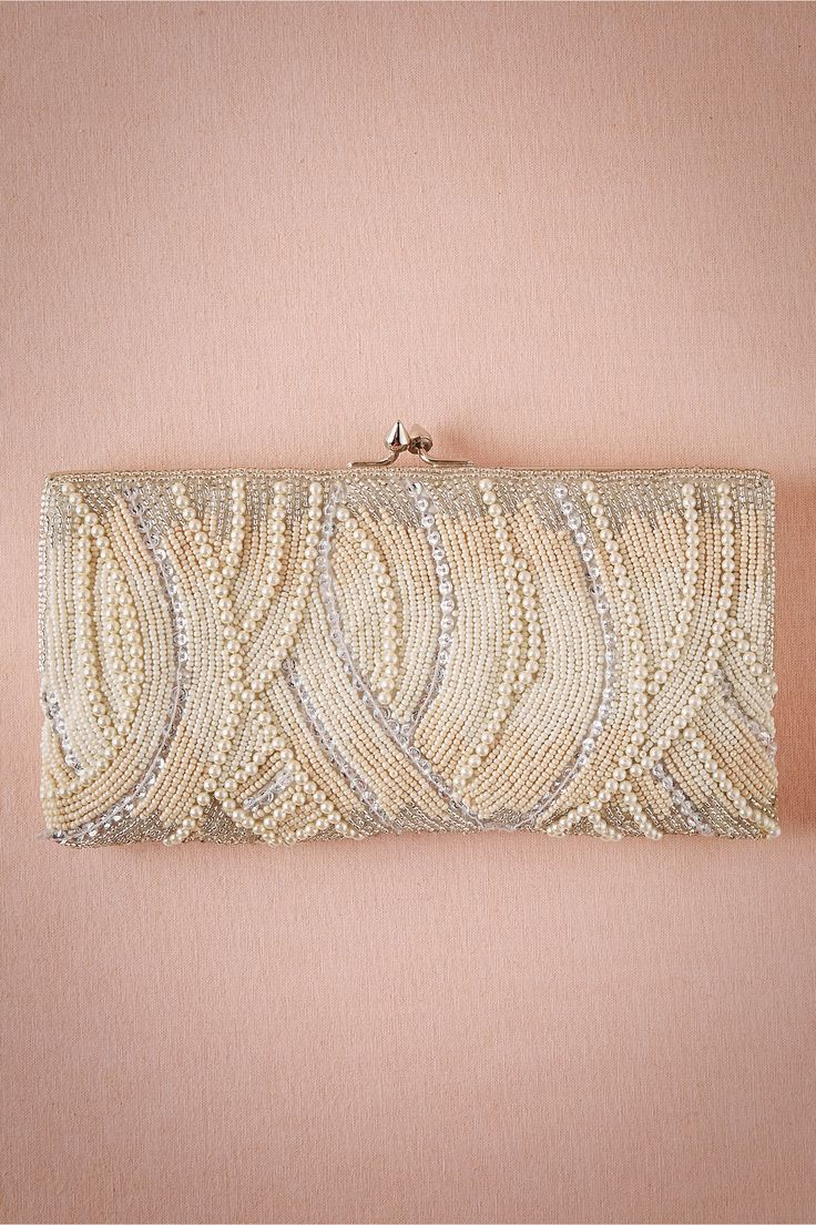 Blushing Clutch from @BHLDN. A lovely beaded clutch for a vintage or romantically styled bride.