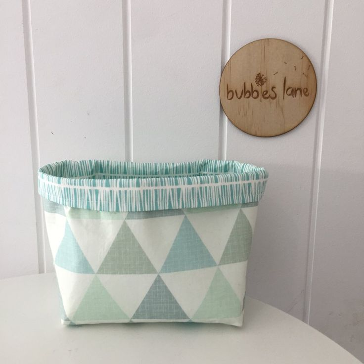 Keep toys and trinkets organised and out of sight with these reversible fabric storage baskets. Pop them on the shelves in your nursery or child's room, or have