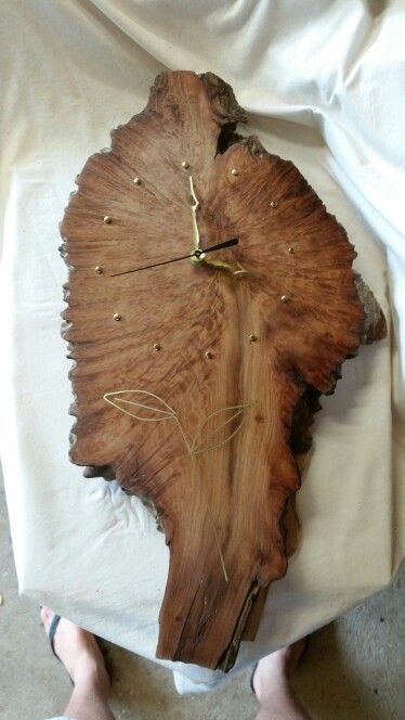 Wall clock made from a jarrah burl with brass inlay.