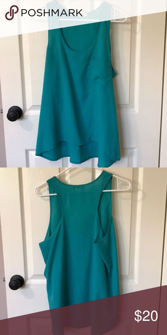 Razorback Tank Top Teal Razorback Tank Top. Can be dressed up or down. Lush Tops Tank Tops