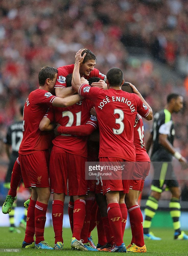 Daniel Sturridge of Liverpool is congratulated by Iago Aspas,Lucas,Philuppe Coutinho,Steven Gerrard and Kolo Toure after scoring the first goal during the Barclays Premier League match between Liverpool and Stoke City at Anfield on August 17, 2013 in Liverpool, England.