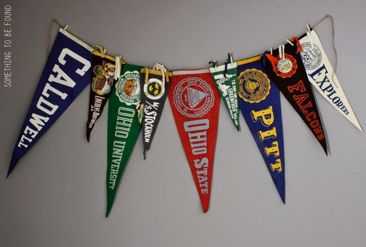 Vintage pennants strung together for decroation in vintage sports room | Something to be Found